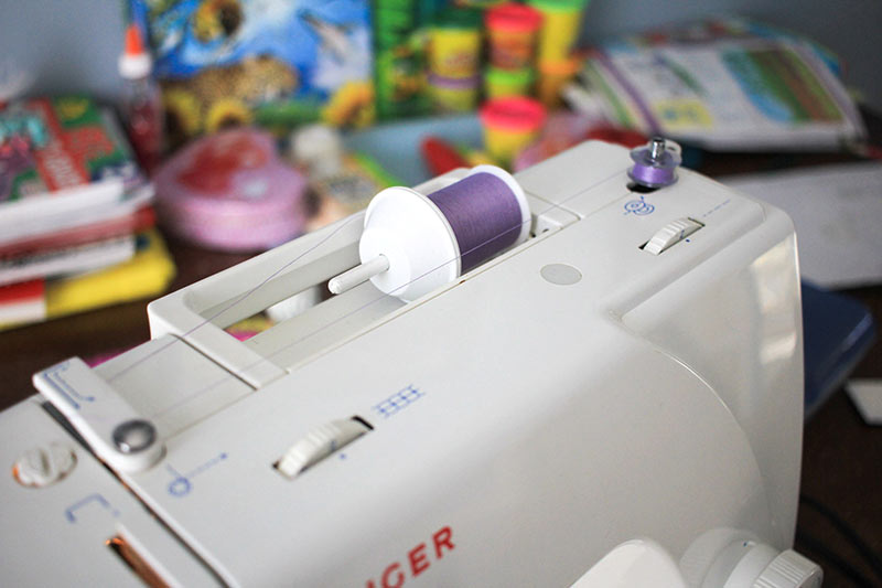 How to get thread on the bobbin