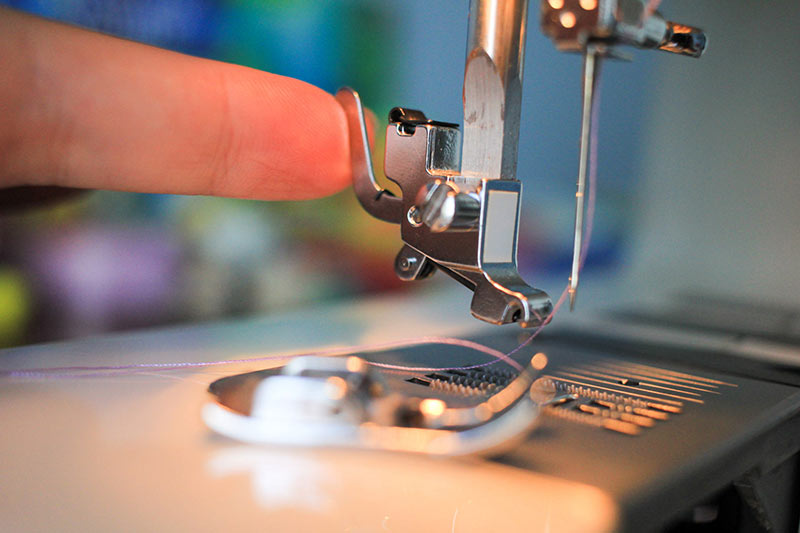 the pressure foot of the sewing machine