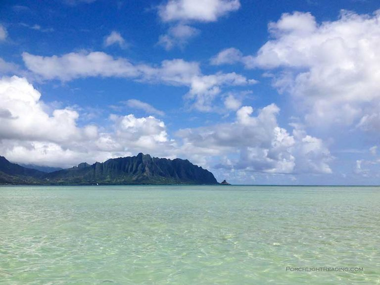 View of mountains on sand bar on Oahu