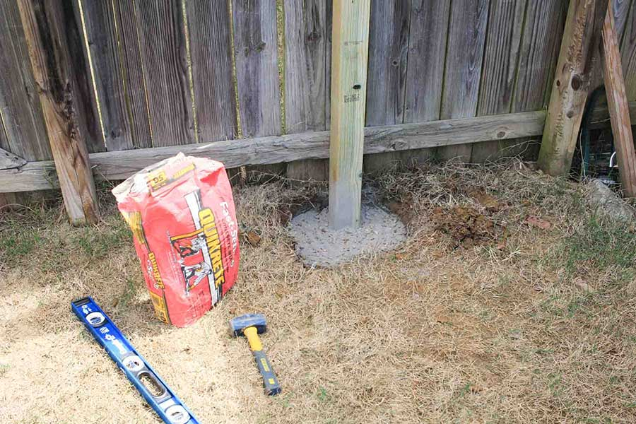 Using quick crete to secure the post