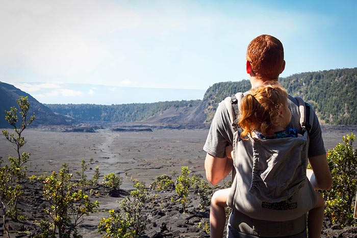 father and daughter looking out over Kileaua Iki crater