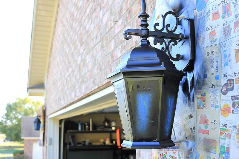 Garage light fixture with second coat of spray paint.