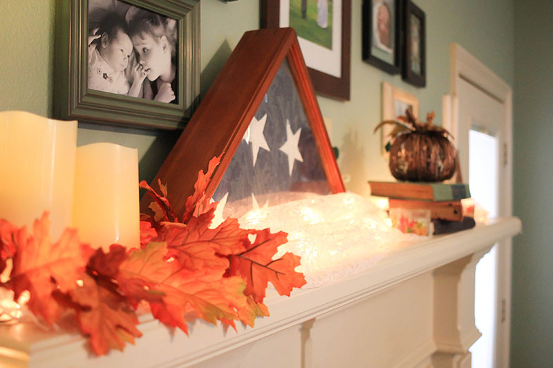 Fireplace mantel with candles and fall accessories