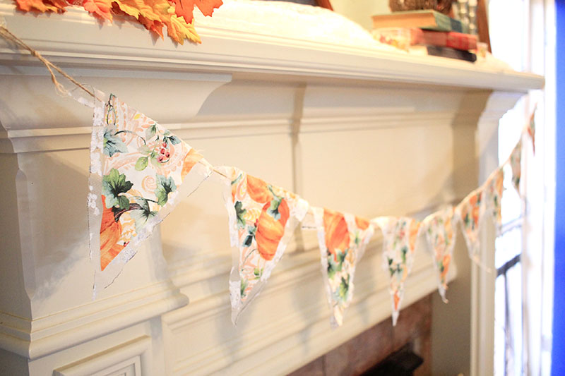 Fall pennant banner hanging from fireplace