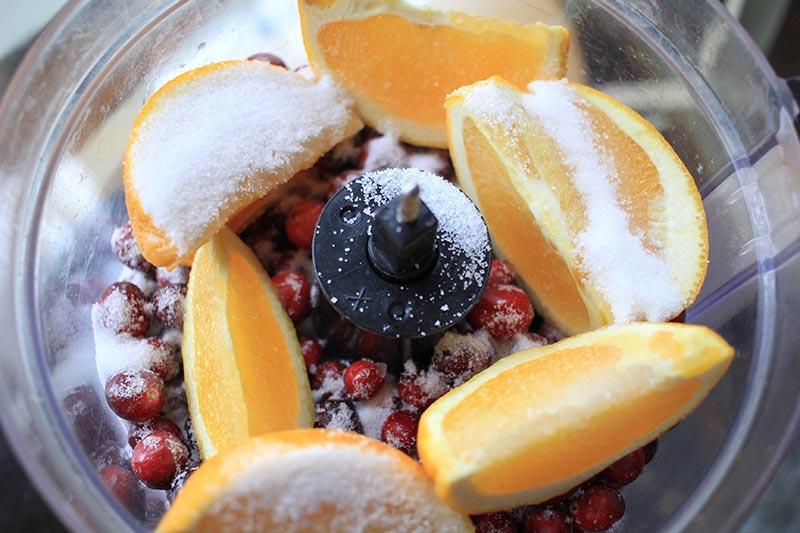 cranberries, orange, sugar and lemon juice in a food processor.