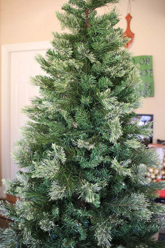 Fake Christmas tree showing no metal pole after being properly fluffed