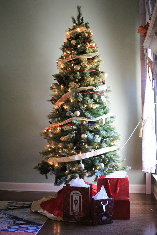 Fake Christmas tree on a DIY stand to make it taller