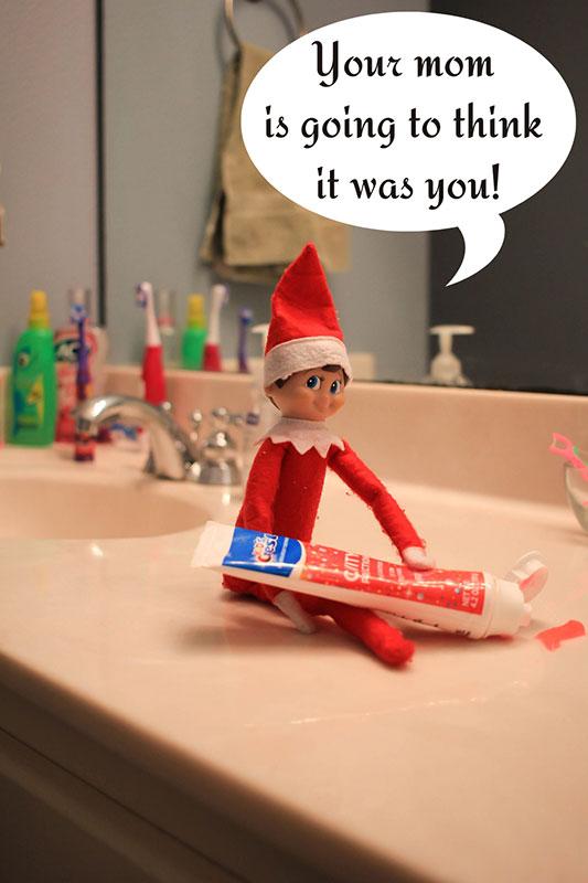 elf squeezing tooth paste
