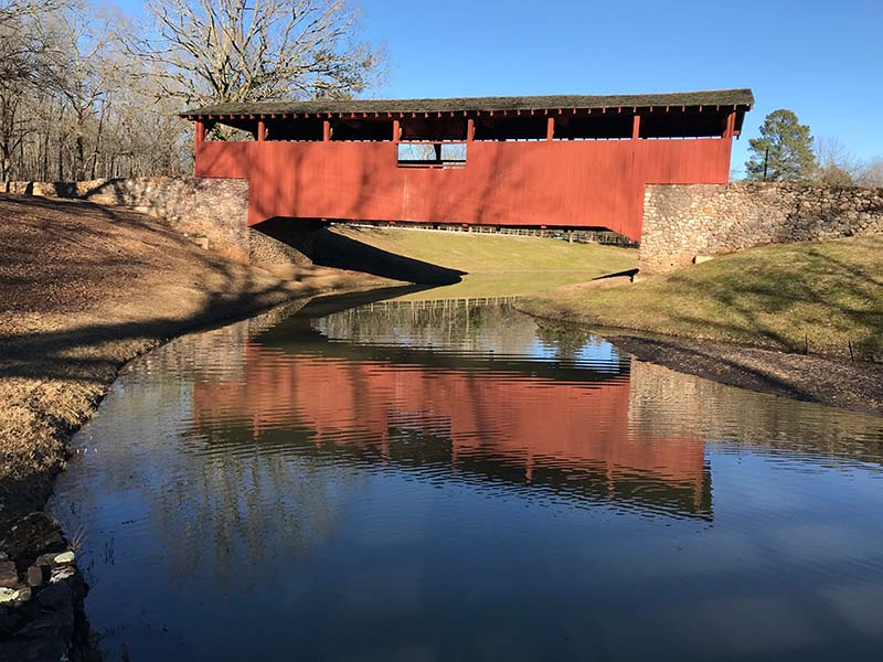 covered bridge over water
