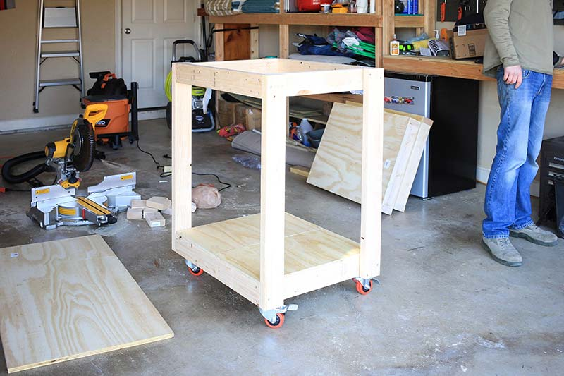 miter saw table with castor wheels and legs attached