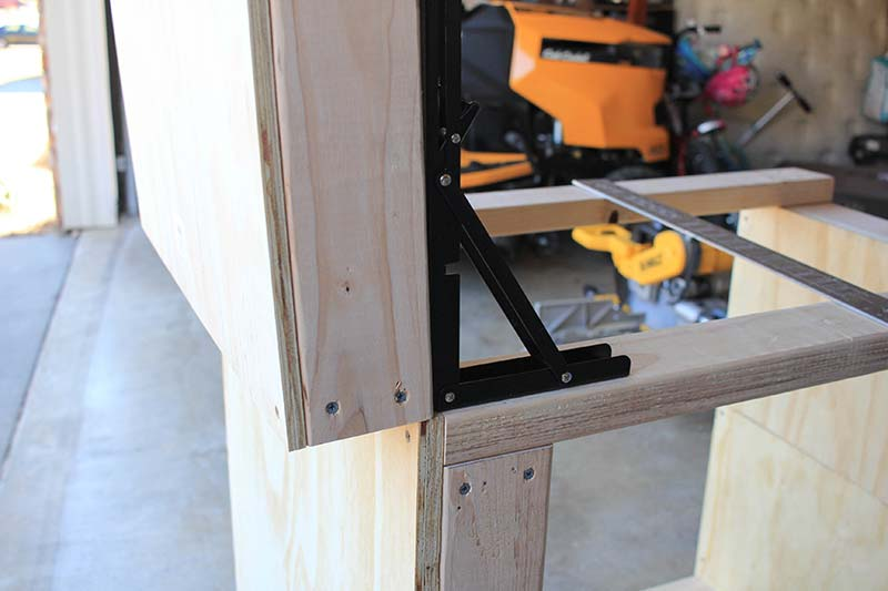 bracket attached to miter saw table wing