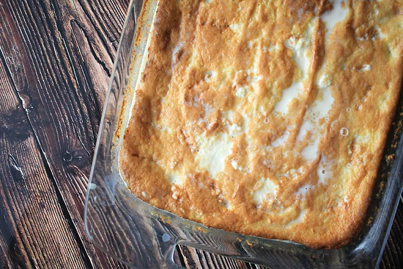 milk soaking into the tres leche cake