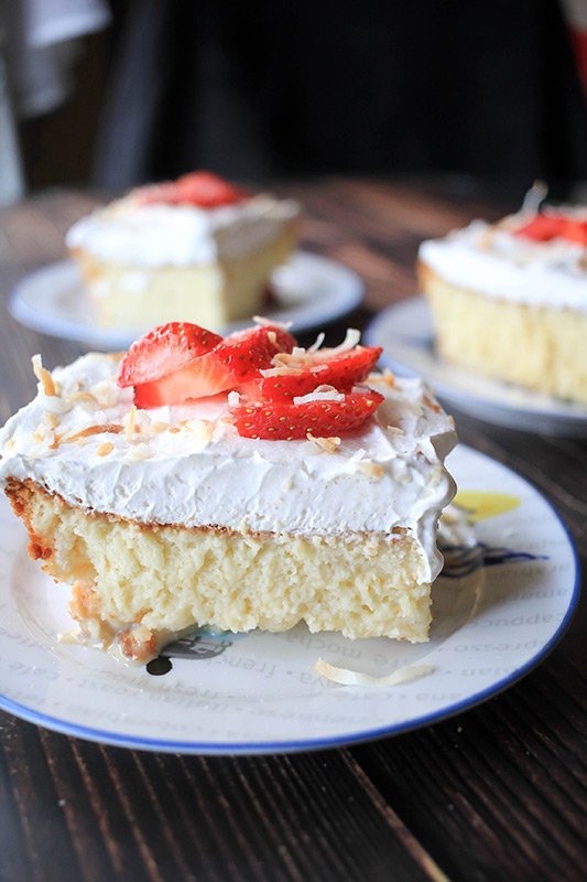 tres leche cakes on wood table