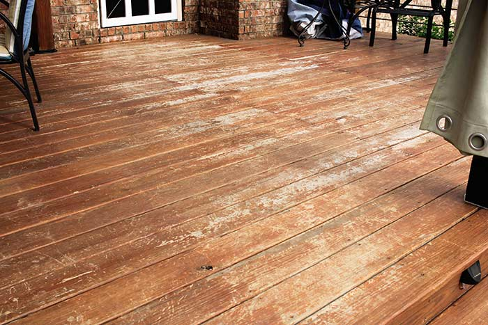 Chipped and worn areas of deck before staining.
