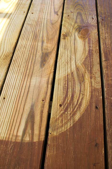 Scratch marks left on deck boards with surface cleaner.