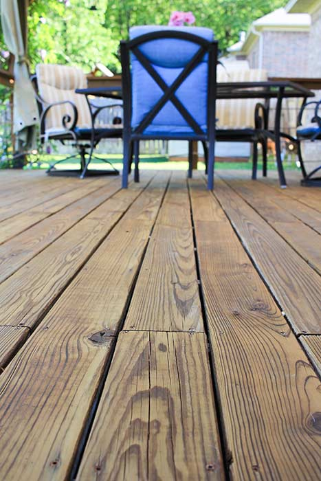 Oil based stain applied to pressure treated deck