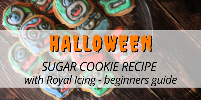 Halloween sugar cookies with royal icing arranged on a glass plate.